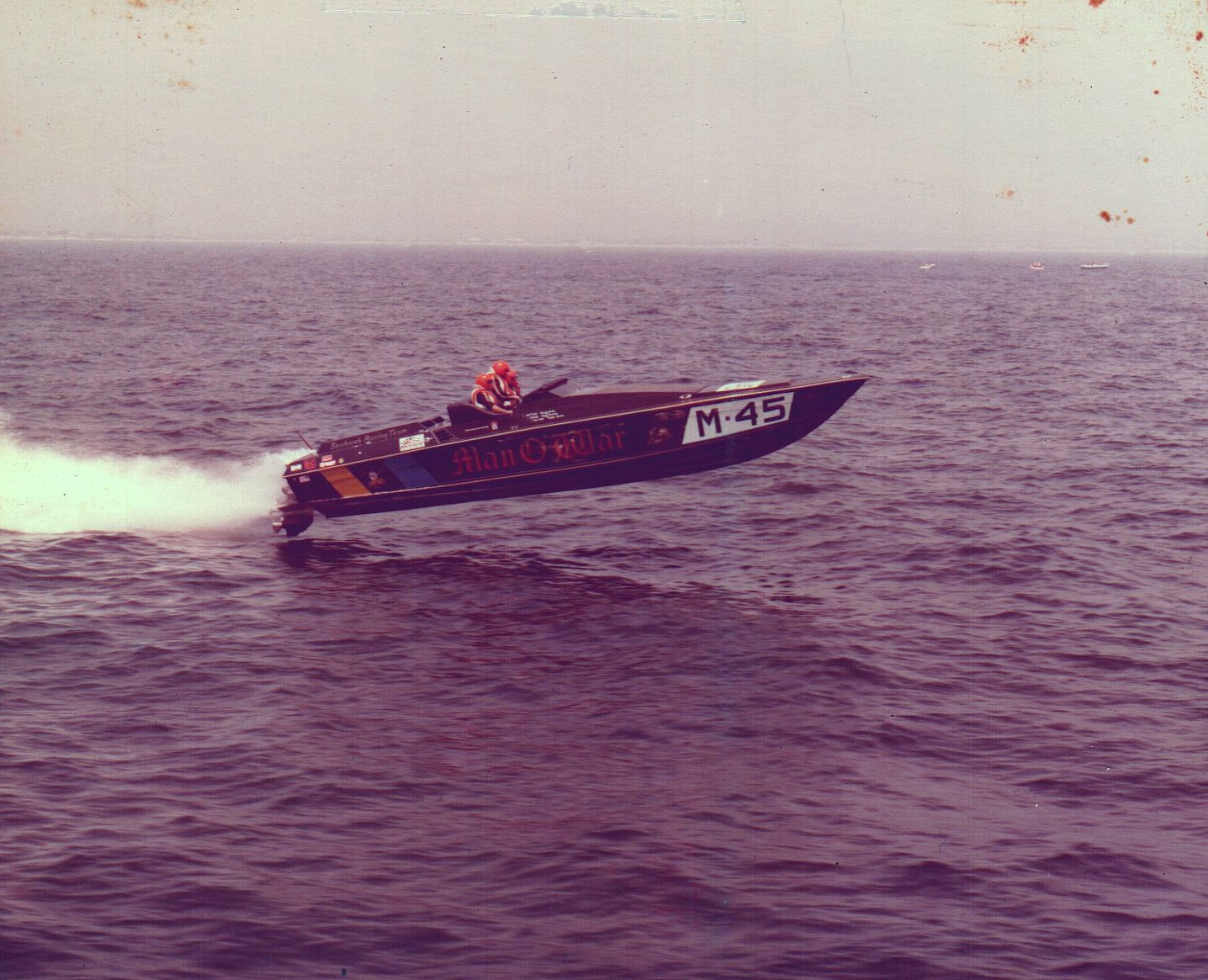 Historical photo: offshore racing boat that george perdomo built the engine for leaps from the water