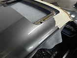 Tape is applied to exterior of Porsche 911 to protect exterior paint while headliner is being installed