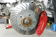 miami porsche in gp autowerks shop having front drilled rotors inspected