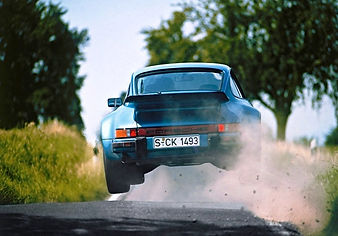 porsche jumping in the air somewhere in europe