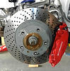Porsche service repair rebuild ppi miami link to services subpage: handling - porsche front brake vented rotor with red caliper