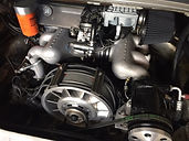 Custom spin-on fuel filter and inline pressure gauge has been added to Porsche 3.2 engine