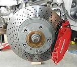 porsche drilled brake rotor being repaired at miami porsche shop of gp autowerks