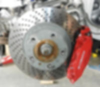 Porsche vented/drilled brake rotor and 4-piston caliper is reference to Porsche's excellent handling in regard to braking