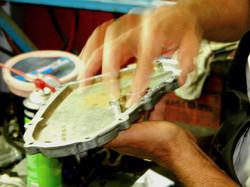 George Perdomo applying liquid gasket to Porsche engine chain housing cover