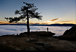 Siloette man over clouds.jpg