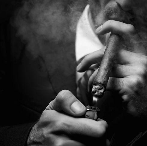 man smoking cigar_edited_edited_edited.jpg