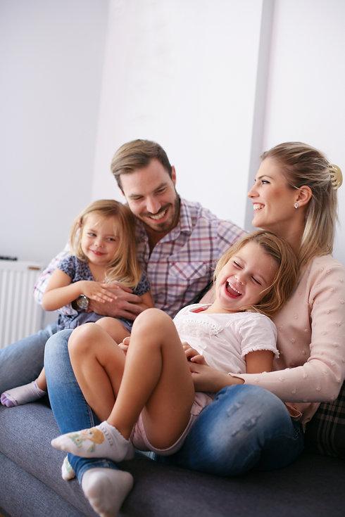 Portrait of family having fun in the living room..jpg