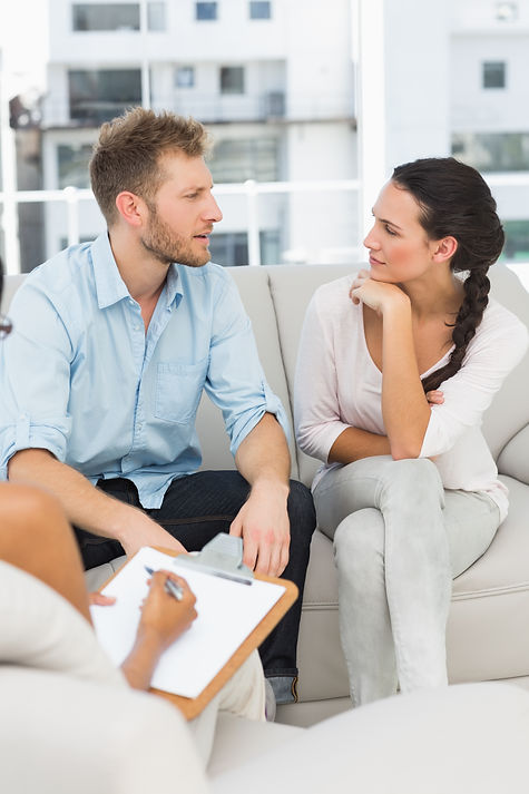Unhappy couple talking at therapy session in therapists office.jpg