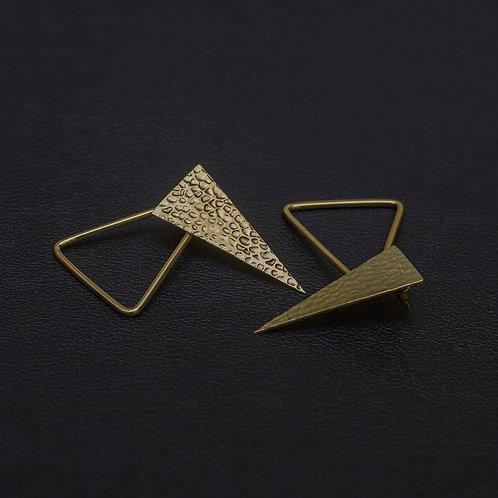 El yapımı geometrik küpeler