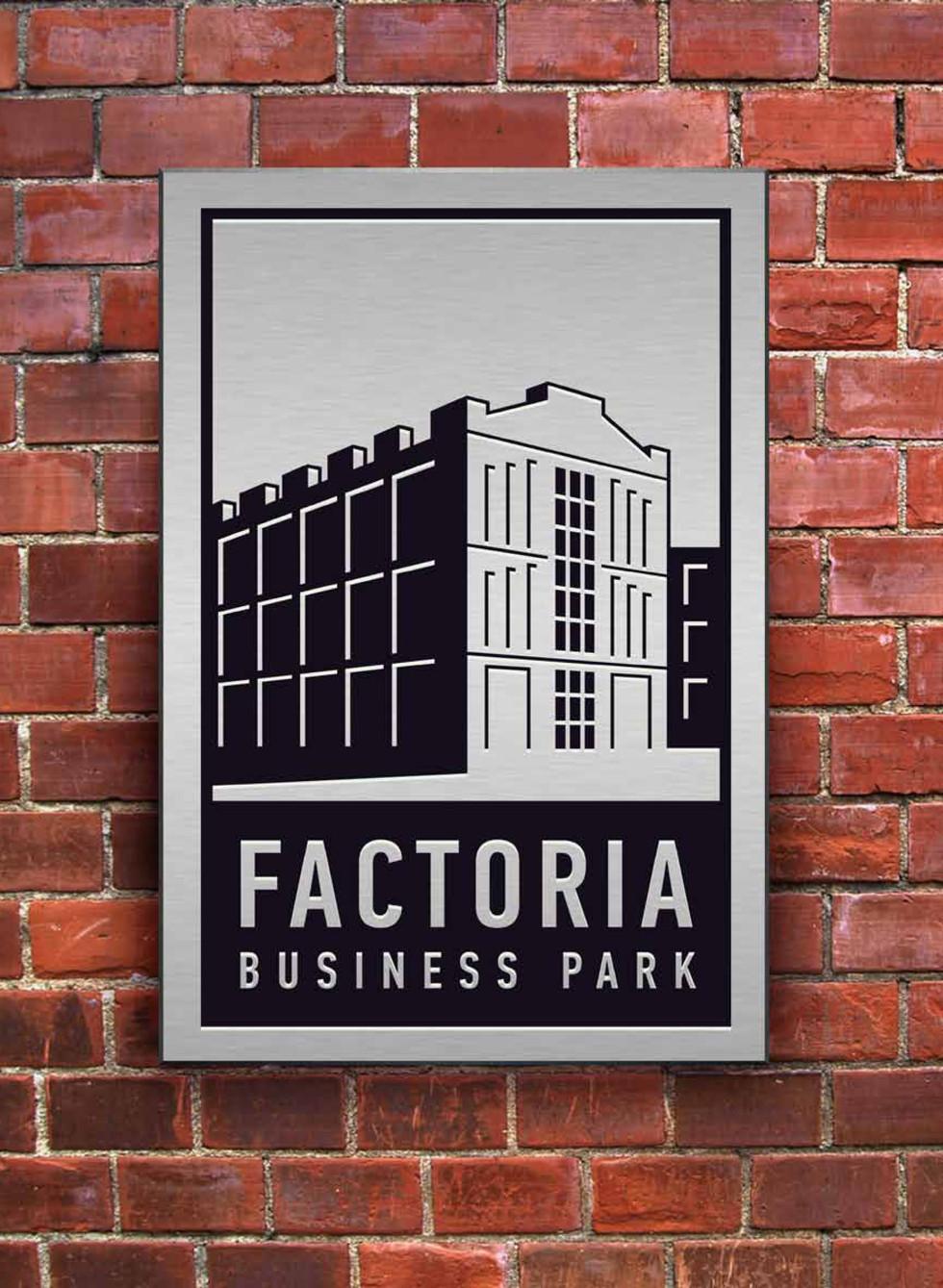 Factoria brick wall sign