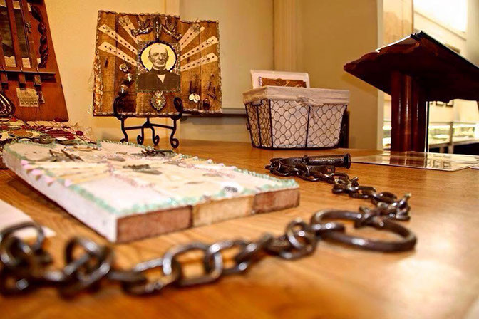 An authentic slave chain with artwork by Hope Demetriades in the background. Photo credit Lucas Demetriades © 2015