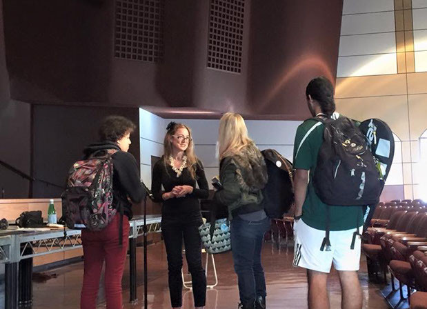 Hope speaks to a group of curious Monrovia High School students after the presentation.