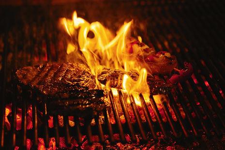 juicy-beef-steak-barbecue-flame.jpg