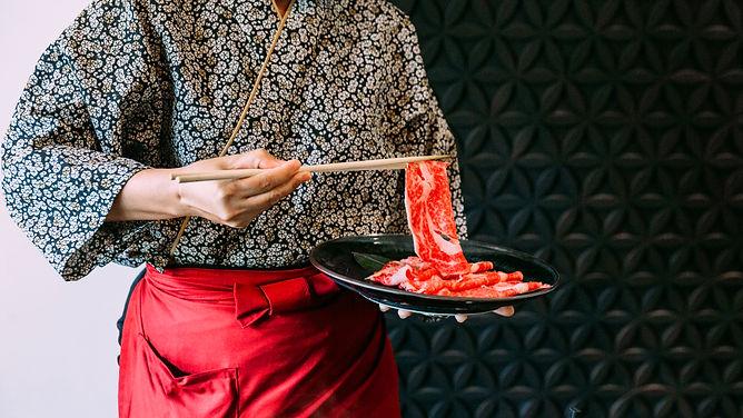 woman-wearing-kimono-holding-rare-slice-