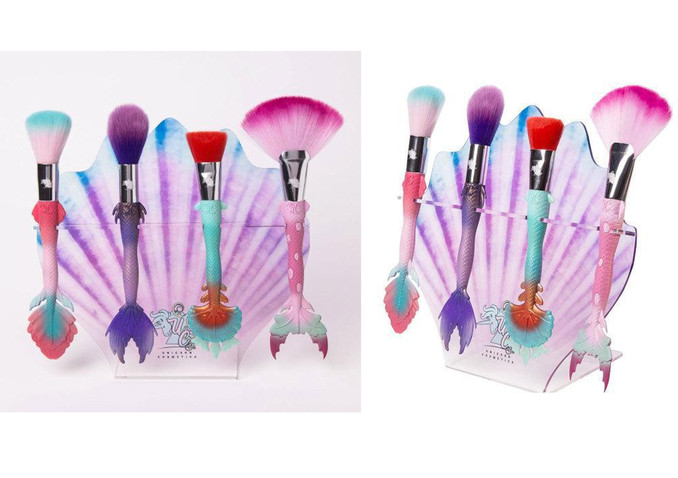 Mermaid brushes in shell stand