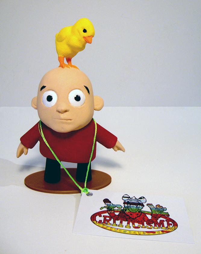 Figurine ''J'ai un poussin sur la tête''