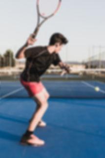 Boy performing a tennis training.jpg