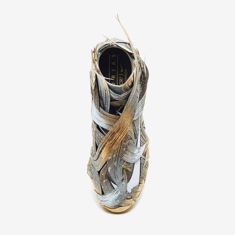 Size : / Medium : paper/spray On Nike shoe  Loacation : Nike Company