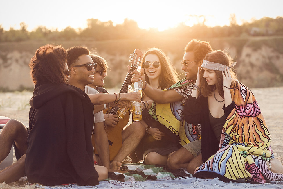 group-of-happy-young-people-sitting-toge