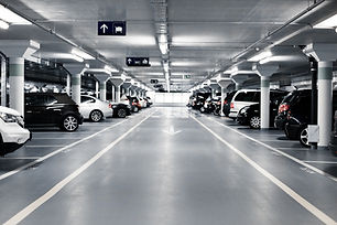 Underground parking with cars. White col