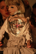 Flicka (with a bird cage for a body)