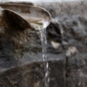 Closeup of water running from outdoor wa