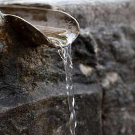 Closeup of water running from outdoor wa