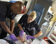 Paramedics performing CPR on patient in ambulance_edited.jpg
