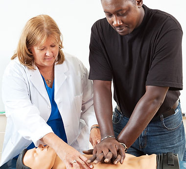 Doctor or nurse instructs an adult student in CPR life-saving techniques._edited.jpg