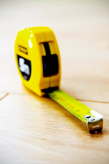 In-home measurements measuring tape on wood