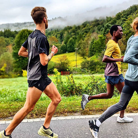 Man, with friends, staring at beautiful scenery while running