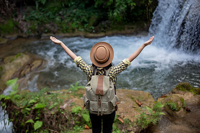 female-tourists-are-happy-and-refreshed-at-the-waterfall.jpg