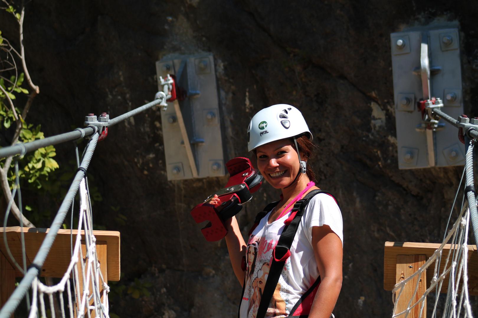 woman holding zipline component