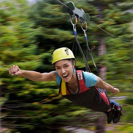 woman in zipline superman harness