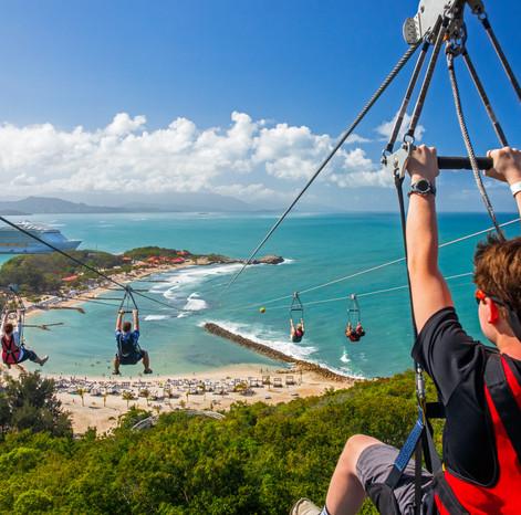 group ziplining over the ocean