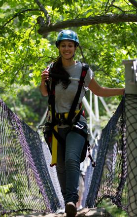 woman walking on suspension bridge