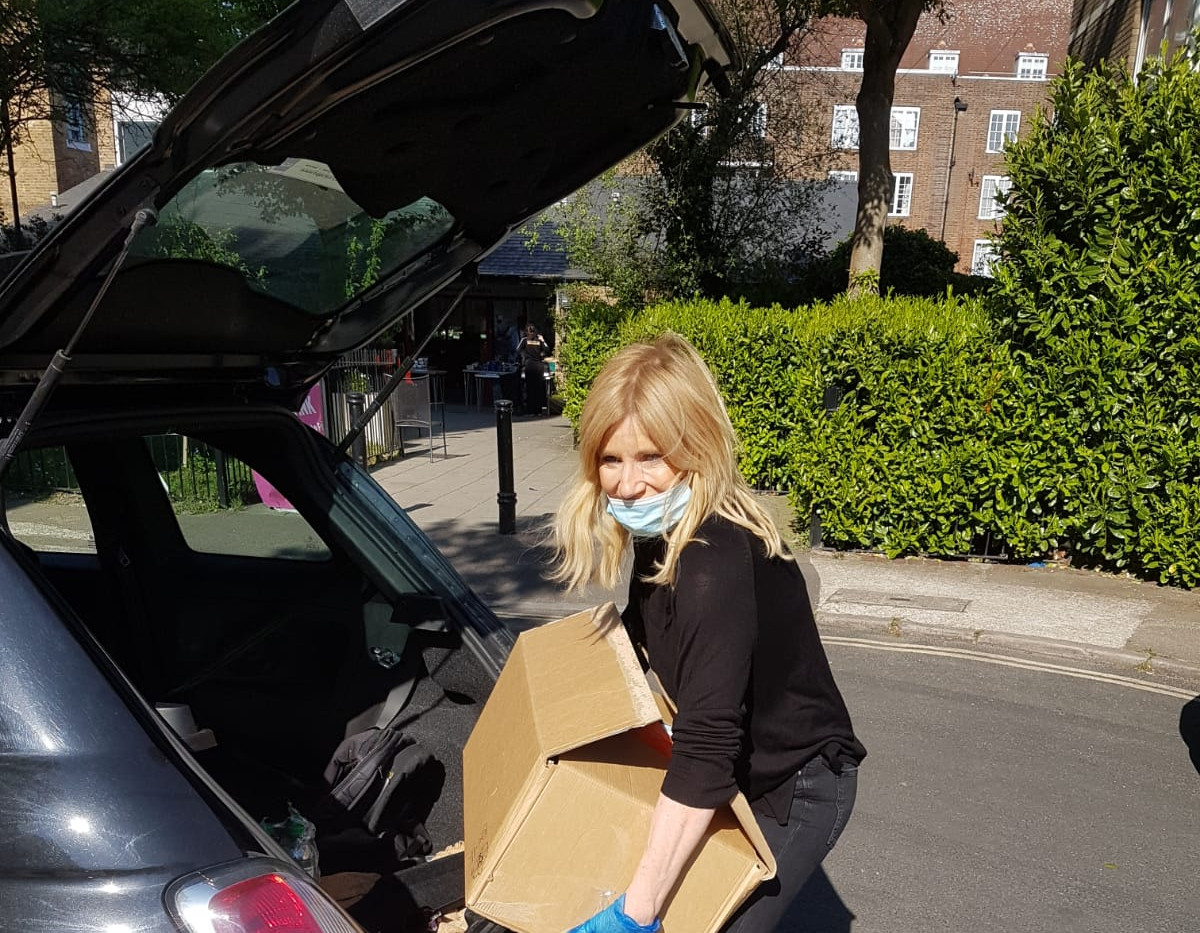 AWTF patron Michelle Collins steps in to help with deliveries