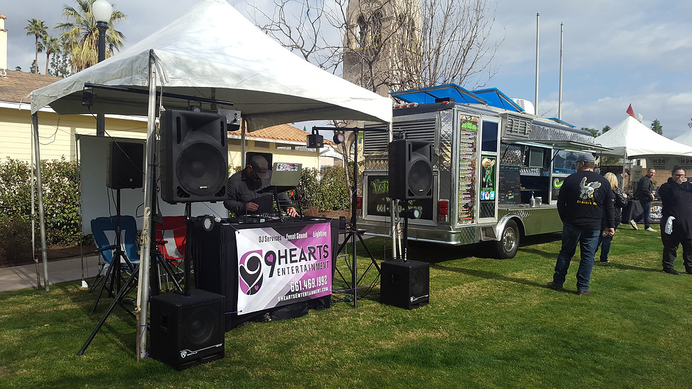 DJ Michael Mauro, finishing his prep work in the booth before the Bakersfield Pizza + Beer Festival got underway.