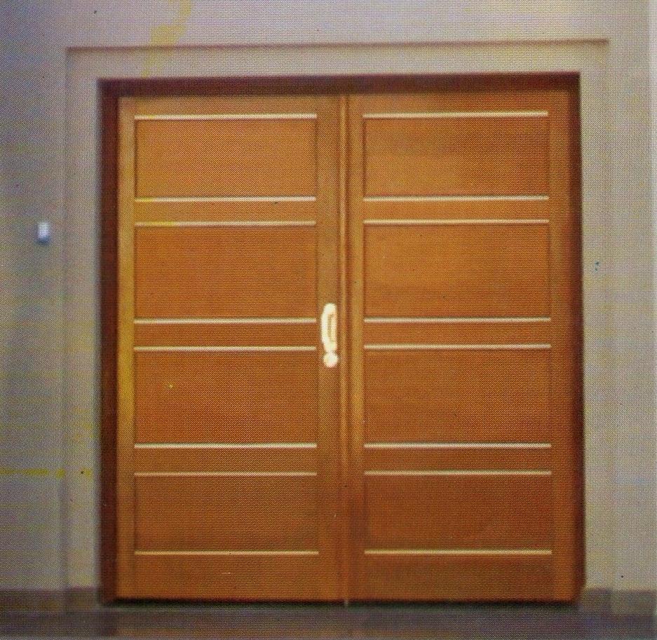 Puerta Cedro con insertos en Aluminio.jpg