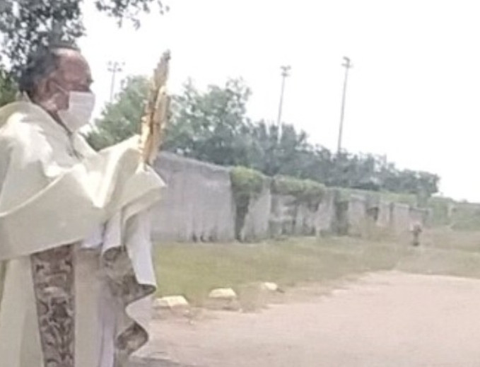 Father Franco with the Blessed Sacrament