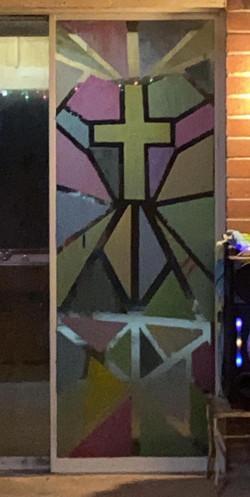Domestic Church window with cross