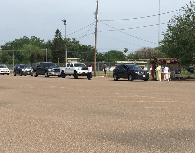 Parishoners in line in their cars to receive a blessing