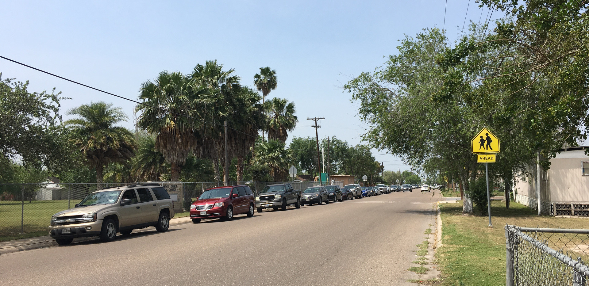Parishoners of St. Francis Xavier in line in their cars