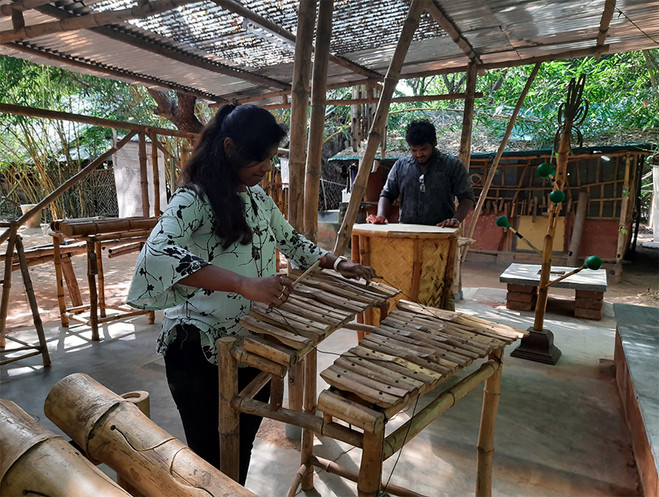 People playing the instruments in the pavilion