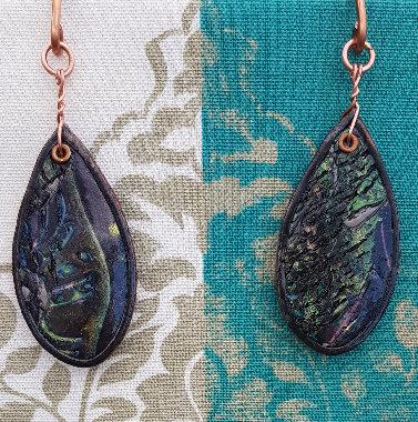 Metallic Dangling Gauged Earrings ..