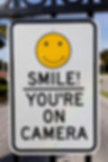 "Graffiti deterrent - ""SMILE You're on Camera"" sign."