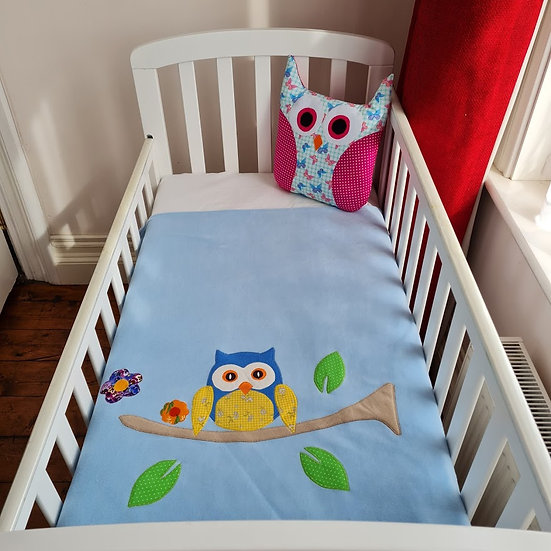 Blue fleece blanket with owl applique design