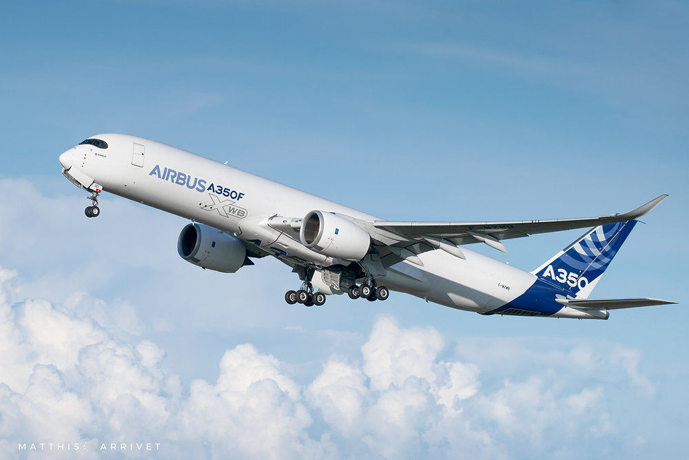Artistic view of an airbus A350-900F is taking off in front of clouds