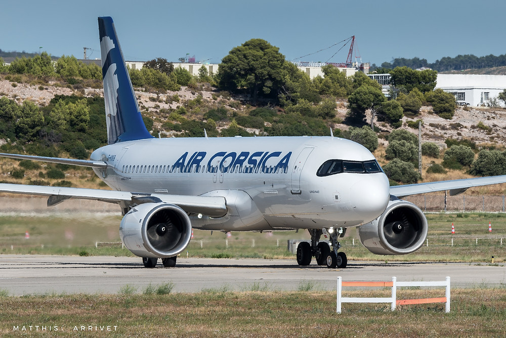 An Airbus A320neo is taxiing on the runway on a sunny day at Marseille Airport